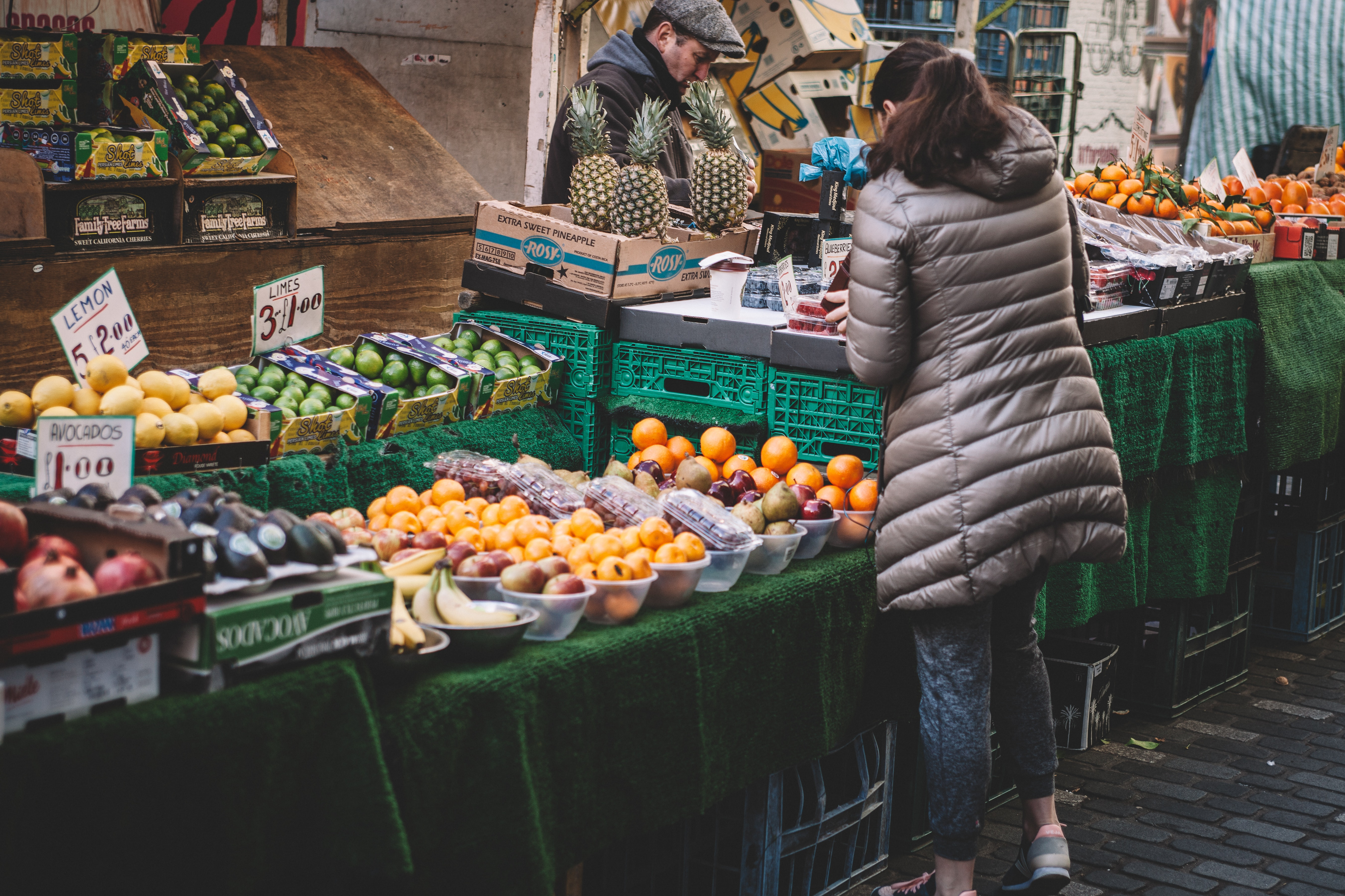 A woman buys food at a market